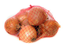 Onions in a net isolated on white Royalty Free Stock Photos