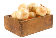 Onions in an old box Stock Photo