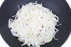 Onions overlying prepared meat in a cauldron Royalty Free Stock Photos