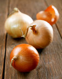 Onions and peel on an old  table Royalty Free Stock Photo