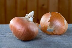 Onions and peel on a table from  boards Royalty Free Stock Image