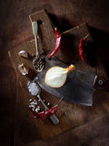Onions, peppers, garlic and other fragrant spices, knife and spoon on a cutting board stock photos