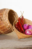 Onions and peppers to the repository. Stock Photos