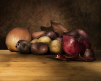 Onions and potatoes. Still life of onions and potatoes royalty free stock image