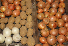 Onions and potatoes. Some onions and some potatoes Stock Image