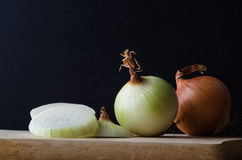 Onions in Preparation on Chopping Board Royalty Free Stock Photos