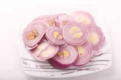 Onions Rings. On white dish over white background Royalty Free Stock Photography