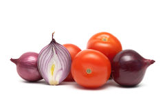 Onions and ripe tomatoes on a white background Royalty Free Stock Image