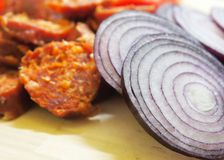 Onions and sausages Stock Images