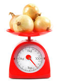 Onions on scales Royalty Free Stock Photography