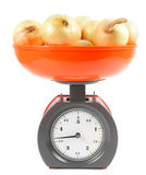 Onions on scales Royalty Free Stock Photos