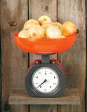 Onions on scales Stock Photos