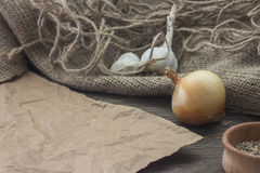 Onions on the table. Next to the garlic Royalty Free Stock Photography