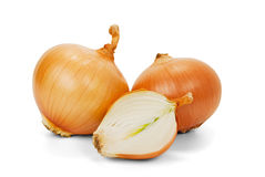 Onions. Three brown onions isolated on white background Royalty Free Stock Images