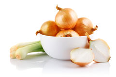 Onions vegetables in white plate with cut Royalty Free Stock Images