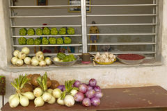 Onions and vegetables in windowsill of El Rincon, Cuba Stock Images