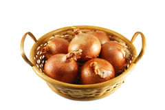 Onions in a wicker basket Royalty Free Stock Images