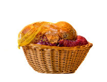 Onions in Wicker Basket. Yellow and Red Onions in a Mesh Bag in Wicker Basket Stock Photo