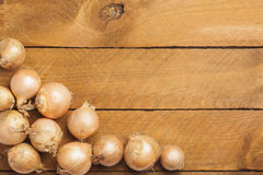 Onions on wood Royalty Free Stock Photo