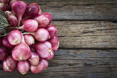 Onions on the wood Stock Photos