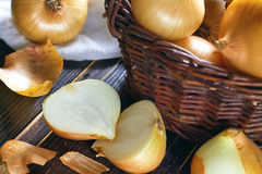 Onions on wooden background Stock Photos