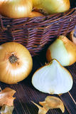 Onions on wooden background Royalty Free Stock Image