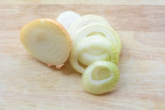 Onions. On a wooden floor Stock Photos