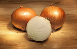 Onions on a wooden table Royalty Free Stock Photography