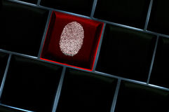 Onliine crime scene concept with fingerprint. Onliine crime scene concept with the fingerprint left on a backlit keyboard Stock Photo