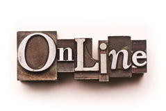 Online. The word Online done in letterpress type on a white paper background Stock Photo