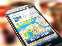 Online accommodation booking concept. Smartphone and system  hot Royalty Free Stock Photography