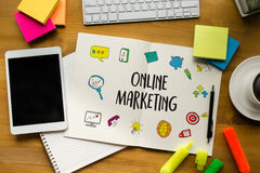 ONLINE ADVERTISING man working on laptop , Online Website Market Stock Photography