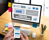 ONLINE ADVERTISING man working on laptop , Website Marketing , U Stock Photos