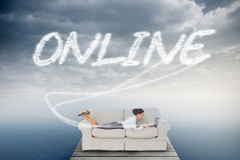 Online against cloudy sky over ocean Stock Photography