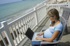 Online Anywhere Mom Stock Photo