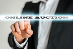 Online auction. Closeup of businessman activating an Online auction button on virtual screen Royalty Free Stock Image