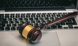 Auction or Judge gavel on a laptop stock photo