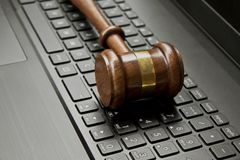 judge gavel on a computer keyboard. stock photo