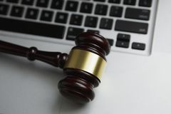 Online auction concept. Auction or judge gavel on a computer keyboard. Online auction concept. Auction or judge gavel on a computer Stock Photos