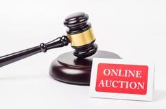Online auction concept. Online auction concept with wooden gavel on white background Stock Photo