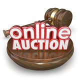 Online Auction Gavel Internet Bidding Web Site Win Buy Item. Online Auction 3d words on a wood block with a gavel closing the bidding on an item in an internet Royalty Free Stock Images
