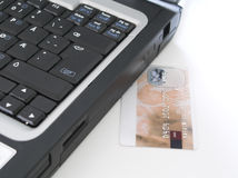 Online Banking. CARD NUMBERS AND NAME ARE PATCHED IN PHOTOSHOP. NOT VALID NUMBERS! Laptop and credit card isolated on white background stock photos