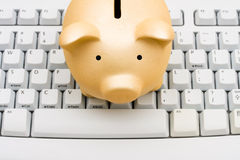 Online Banking. A piggy bank sitting on a computer keyboard, online banking Stock Photos