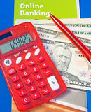 Online Banking. An image of a red solar calculator with matching pen, dollar bills and bold white  text on green saying ' Online Banking Royalty Free Stock Photography