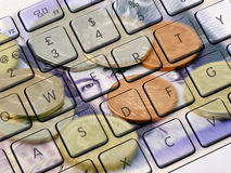 Online banking. Closeup of computer keyboard overlaid with photo of UK money stock photography