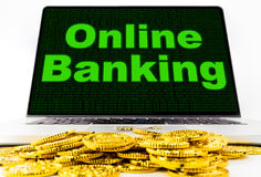 Online Banking for financial on Laptop computer with golden coin Royalty Free Stock Photos
