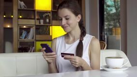Online banking with smart phone. In cafe stock video