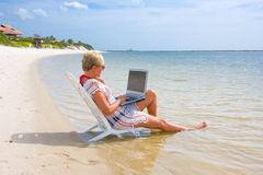 Online on the beach Royalty Free Stock Image