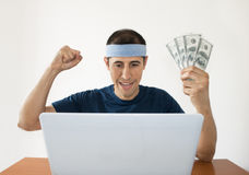 Online betting dollar gaining. Online betting man and making a lot of dollar Stock Photo