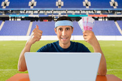 Online betting in euro. Online betting man and making a lot of euro in the stadium stock photography